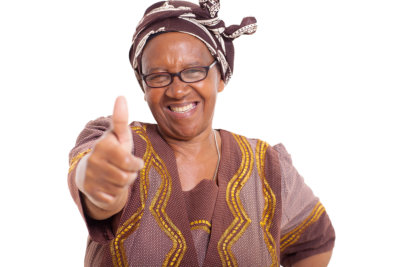 mature african woman with happy smile giving thumbs up on white background